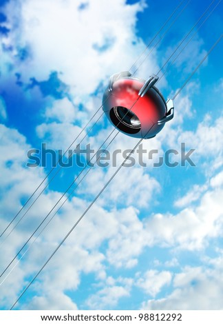 A futuristic space elevator is seeing through the clouds towards space. The Space Elevator uses a carbon nanotube ribbon that stretches from the surface of the earth to a counterweight in space. - stock photo