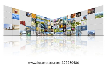 A futuristic video wall with 100 screens some are off - stock photo