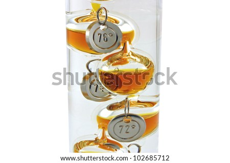 A Galileo thermometer isolated against a white background - stock photo