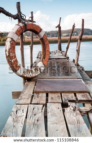 A gangway over the water with a lifebuoy in Asturias (Spain) - stock photo