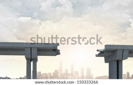 A gap in the concrete bridge ad a symbol of risk and danger - stock photo