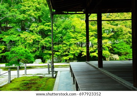 https://thumb9.shutterstock.com/display_pic_with_logo/167494286/697923352/stock-photo-a-garden-at-temple-in-kyoto-697923352.jpg