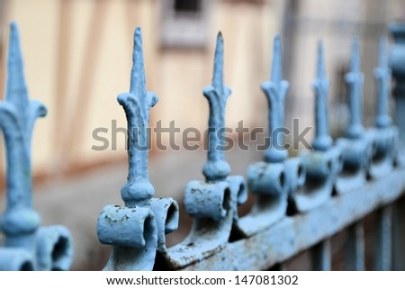 a garden fence in front of a house - stock photo