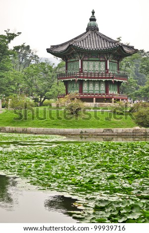 A garden pond with a Chinese style pagoda in the city of Seoul, Korea - stock photo