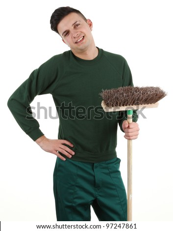 A gardener with a broom isolated on white - stock photo