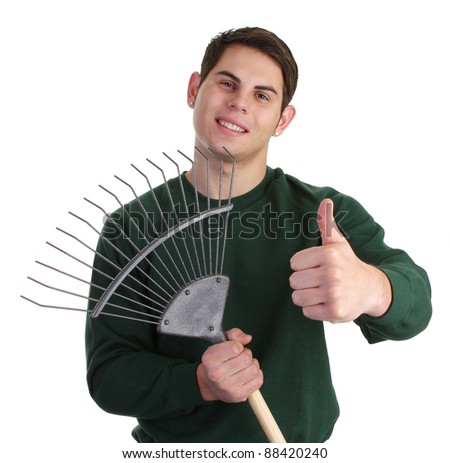 A gardener with a thumbs up sign and a fork - stock photo