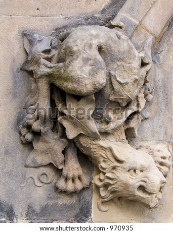A gargoyle carved on the walls of St Martin's Church in Birmingham - stock photo