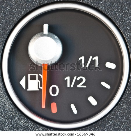 A gas gauge shows low petrol level - stock photo