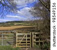 A gate on a footpath. - stock photo