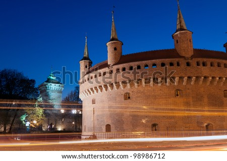 A gate to Krakow - the best preserved barbican in Europe, Poland by night - stock photo