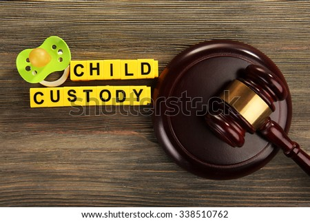 A gavel, a dummy and blocks regarding child-custody and divorce concept - stock photo