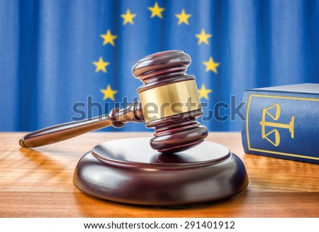 A gavel and a law book - European union - stock photo