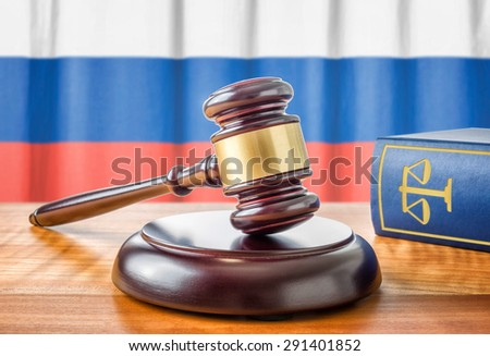 A gavel and a law book - Russia - stock photo