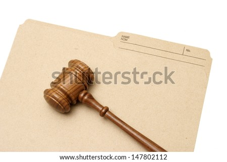 A gavel and folder represent legal documents.
