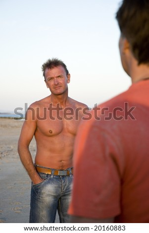 A gay man looks towards his partner during a dispute - stock photo