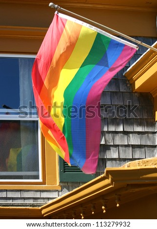 A gay pride flag waving in the wind - stock photo