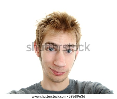 A generic white Cauasian young adult male smiling with a pleasant look on his face. - stock photo