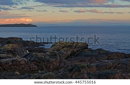 A gentle sunset off the rocky west coast of Vancouver Island, British Columbia. / Vancouver Island Sunset - stock photo