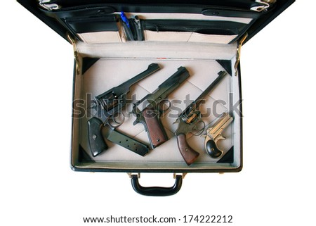 A genuine briefcase filled with Guns. Could be a Hit Man's Arsenal, or a FBI Sting or CIA Mole or a Gun Collector going to a gun show. You decide. The Perfect image for all your need. isolated  - stock photo