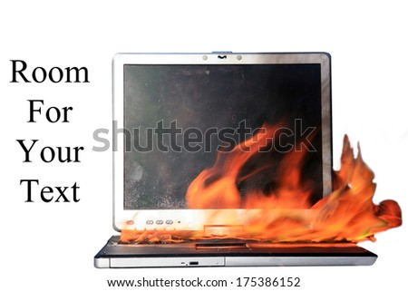 A Genuine Laptop Computer on fire. Isolated on white with room for your text. Represents Computer Damage, Insurance Claims, Fire Danger, Work Protest, Burning up the internet, Hot Chat and E Mails etc - stock photo