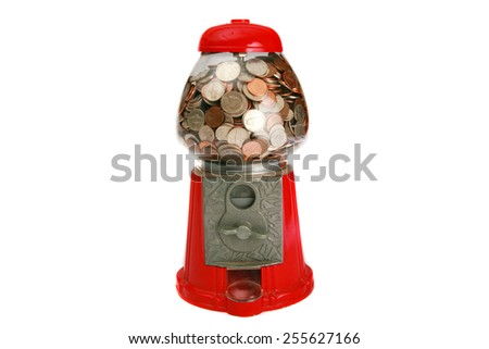 A Genuine Table-sized Gum Ball Machine, filled with change of quarters, dimes, nickles, pennies. put in a quarter and take your chances. Painted in cheerful colors, massive, metal-glass structure.  - stock photo