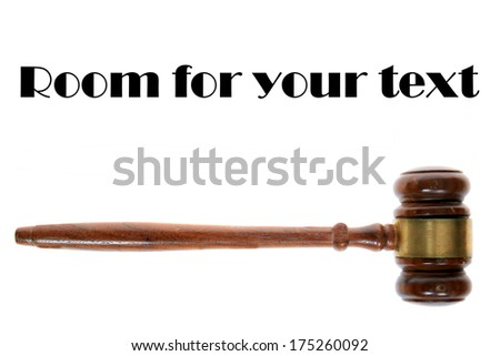 A Genuine wooden judges gavel, isolated on white with room for your text. Judges and others use Gavels to make a final point and to mark the end of a trial or conversation as the Last Word.  - stock photo
