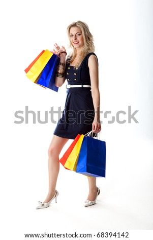 A German beauty is out for shopping and carries six paper bags