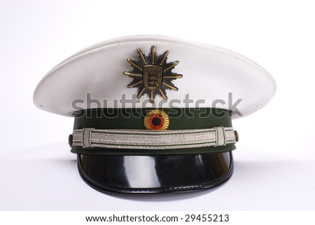 a German police hat, against a white background - stock photo
