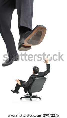 A giant foot about to squish a businessman in a chair isolated on a white background - stock photo