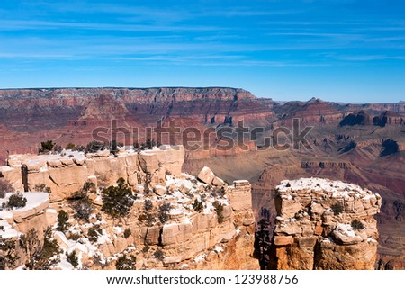 A giant ledge covered with snow at the Grand Canyon in Arizona - stock photo