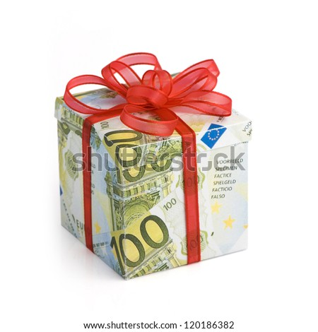 A gift box covered in Euro banknotes with red colored ribbon applied