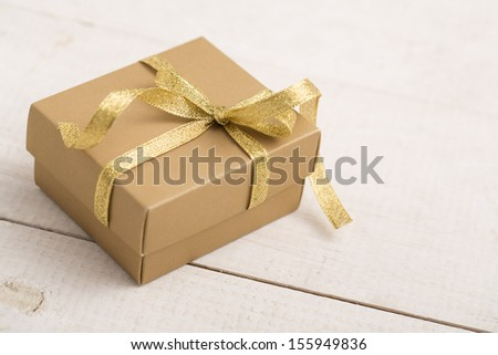 A gift box on a wooden background