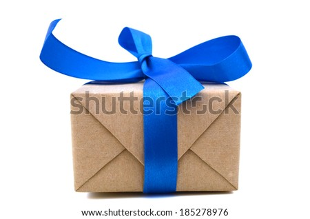 A gift box wrapped in recycled paper with ribbon bow, isolated  - stock photo