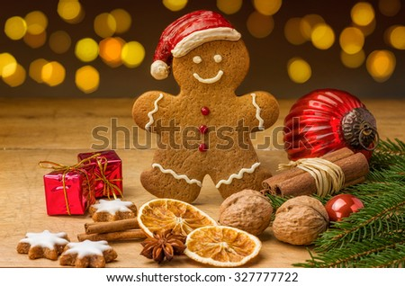 A gingerbread santa with christmas decorations - stock photo