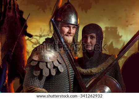 A girl and a guy in a medieval knight's armor - stock photo