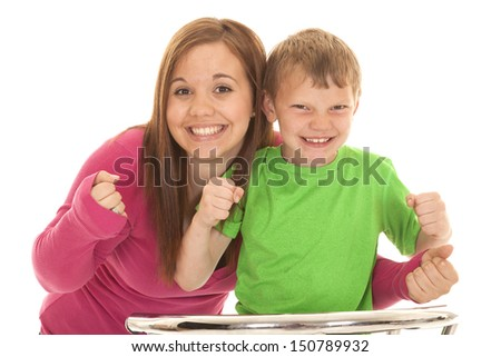 A girl and a young boy both very excited. - stock photo