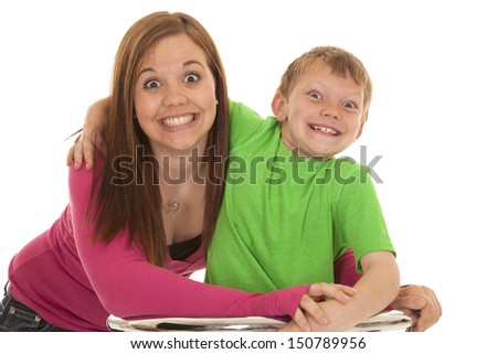 A girl and a young boy with big smiles - stock photo