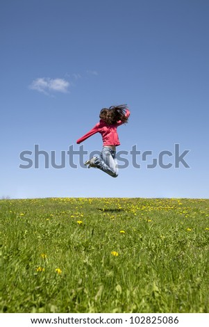 A girl caught in mid jump.