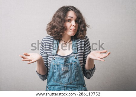 A girl do not know what to do - stock photo
