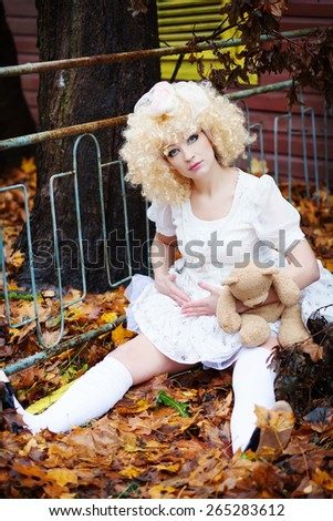 a girl dressed as a doll - stock photo