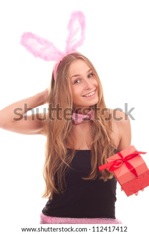 A girl dressed as a rabbit with gifts studio shooting - stock photo