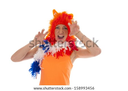 a girl, dressed as an orange lion, like a supporter of the dutch soccer team - stock photo