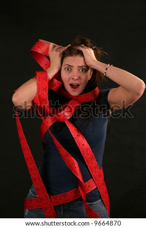 "a girl expresses frustration with the concept of being ""Caught up in Red Tape"" - stock photo"