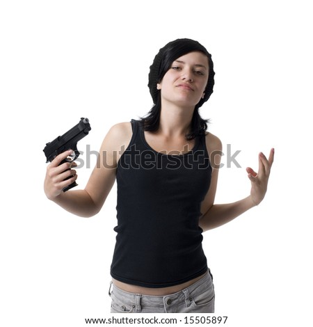 A girl gestures like a gangster with a gun - stock photo