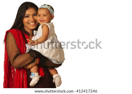 A girl holding a cute baby - stock photo
