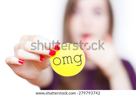 "A girl holding an ""omg"" sign with the focus on the sign and the girl faded in the background, isolated on white. - stock photo"