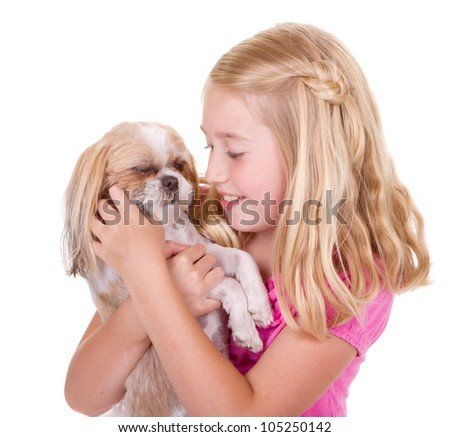 A girl holding and petting her shih tzu dog - stock photo