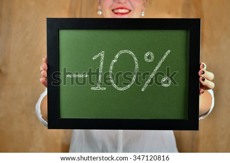 a girl holds a sign saying sale - 10 percent - stock photo