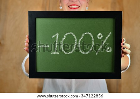 a girl holds a sign saying sale - 10percent - stock photo