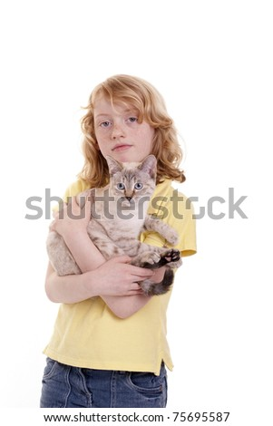 A girl holds her cat in the arms - stock photo